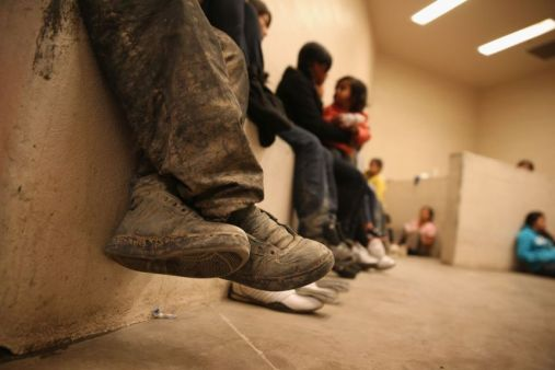 MCALLEN, TX - SEPTEMBER 08: Women and children sit in a holding cell at a U.S. Border Patrol processing center after being detained by agents near the U.S.-Mexico border on September 8, 2014 near McAllen, Texas. Thousands of immigrants, many of them families and unaccompanied minors, continue to cross illegally into the United States, although the numbers are down from a springtime high. Texas' Rio Grande Valley area is the busiest sector for illegal border crossings into the United States. (Photo by John Moore/Getty Images) ** OUTS - ELSENT, FPG - OUTS * NM, PH, VA if sourced by CT, LA or MoD **