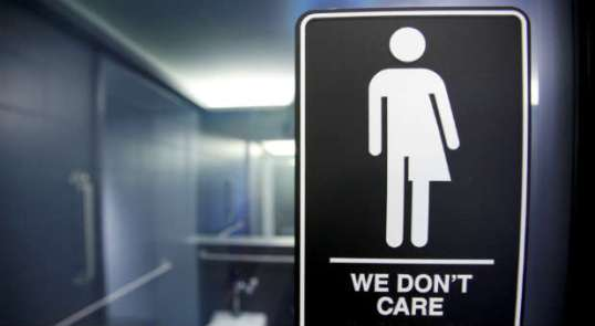 Reuters-bathroom-dont-care-sign