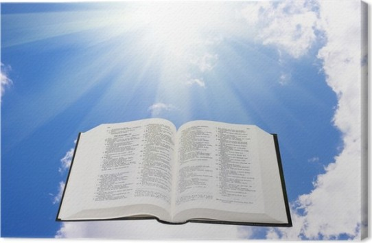 Holy bible in the sky illuminated by a sunlight